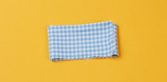 gingham material folded twice